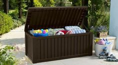 Add extra seating and storage space to your home with the beautiful Keter 214301 Rockwood 150 Gallon Deck Box . Outdoor Storage Boxes, Plastic Sheds, Garden Storage Shed, Large Cushions, Deck Box, Pool Supplies, Built In Storage, Outdoor Areas, Storage Spaces
