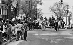 In this March 16, 1965 file photo, mounted state and county police officers ride their horses into a group of demonstrators after they refused to disperse in Montgomery, Ala.