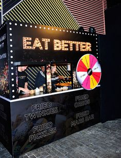 """An """"eat better"""" station offered an array of deep-fried foods—and a spinning wheel to help guests decide which indulgence to choose."""