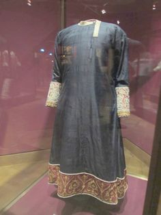 """Tunicella, before 1246, Kunsthistorisches Museum This was made in Palermo (which means I could be related to whoever wore it, but probably not), but its date of creation is unknown. All we know is that it was mentioned in documents twice: once in 1350 where it was called """"a blue gown"""", and once in 1246 where it was called a """"gown of samite""""."""