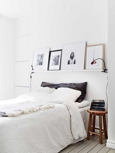 simple bedroom.  Love the pictures sitting on the railing and the slate grey pillows.
