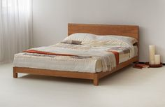 Hand-built the Sonora is a contemporary low wooden bed. Available in many solid timbers including pine, oak and cherry. Buy online. Free UK Delivery.