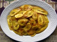 Pan Fried Plantain Chips ((I love fried plaintain chips. I usually dust them in a bit of cornstarch and dust with regular sugar when I pull them out of the pan.))