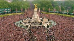 The crowd moves down the Mall, toward Buckingham Palace, to watch a kiss between Britain's Prince William and his wife Kate, the Dutchess of Cambridge, druring the Royal Wedding