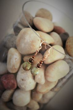 Check out this item in my Etsy shop https://www.etsy.com/listing/265115084/serpentine-and-copper-drop-earrings