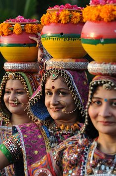 Indian folk dancers from the Panghat Group of Performing Arts participate in a full dress rehearsal for the forthcoming Navratri festivities or Dance Festival of Nine Nights in Ahmedabad. AFP PHOTO / Sam PANTHAKY Only in India We Are The World, People Of The World, Bollywood Stars, Ahmedabad, Amazing India, India Culture, Indian People, India Art, Folk Dance