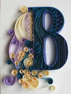 really neat quilling, she did the whole alphabet.