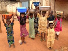 peacecorps:     Cute kids fetching water gathering...