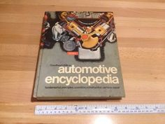 """1975 Automotive encyclopedia, 8 3/4"""" x 11 1/4"""" x 1 1/2"""", Hardcover 768 pages, asking $20."""