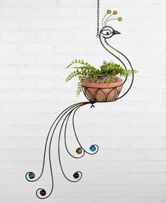 Peacock Hanging Planter is part of Hanging planters - 21 x x 32 Includes 10 chain and hook for hanging Flower Planters, Hanging Planters, Flower Pots, Garden Planters, Diy Garden, Garden Projects, Metal Plant Stand, Plant Stands, Wrought Iron Decor
