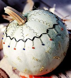 Decorate a moon-white pumpkin with an intricate Native American design.