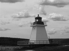 Neils Harbour Lighthouse - Nova Scotia (Cape Breton).   By the sea.  Photo by J. Underwood.