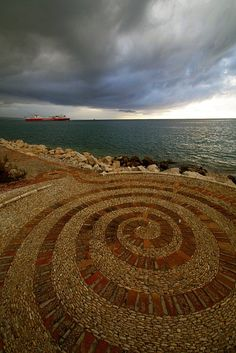 Archimedean spiral - Patra, Greece .   The Archimedean spiral (also known as the arithmetic spiral) is a spiral named after the 3rd century BC Greek mathematician Archimedes.