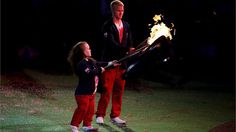 Swimmer Eleanor Simmonds andsprinter Jonnie Peacock of Great Britain light torches from the Paralympic Flame as it begins to fade They light their Torches from the dying Flame and proceed to light various torches held by members of the Closing Ceremony cast.