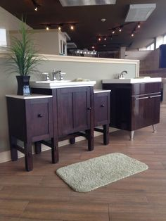 Dark wood bathroom complimented by white porcelain accents.