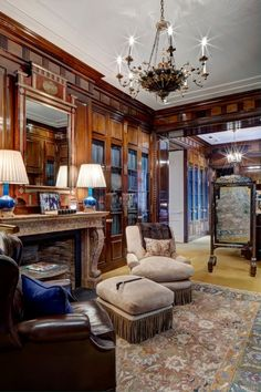 This master suite sitting room is fabulous! Look at the woodwork- & the marble fireplace. I like the touches of Prussian blue. Old World elegance at its best.