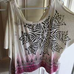 Cold shoulder crop top Gorgeous cream colored with a black flower designs with studs then it has a light to dark pink design along the bottom. Tie back with keyhole design. Pre loved, gently worn. Tag says Premium Vanity Collection. Vanity Tops Crop Tops