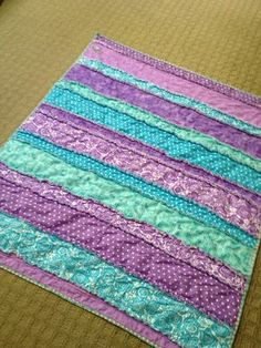 I made this baby rag quilt for a purple and teal nursery.  I have made these before with squares but this is the first time with fabric I cut into strips.  It was easy and fun.  The more it is washed the softer it will be with a flannel lining.  Cute flower applique in the corner for a baby girl.
