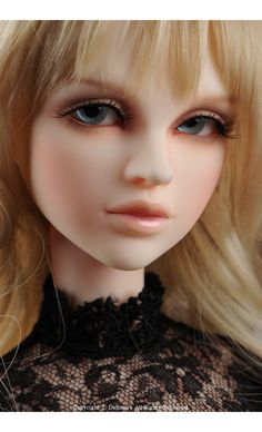 Dollmore.net :: Everything for Doll & more . . . Not your typical Barbie Doll!!   Love the facial features.