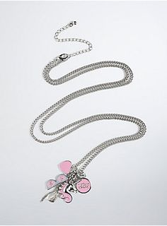 """This charm necklace is inspired by everything Rebel loves; from the """"Rebel"""" script pendant to a unique unicorn charm to sunglasses that only see $$$ signs. Designed exclusively for Torrid by Rebel Wilson."""