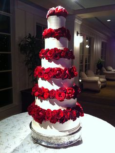 Beautiful wedding cake with red roses