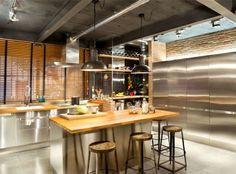Industrial Loft Space With Fresh Green Decor kitchen chrome appliances