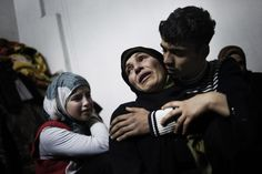 """Syria - Alessio Romenzi - A mother and her children cry over the loss of two of her sons, who were killed in a mortar attack launched by Assad forces in Homs province.  """"So far, most of the killing in Syria — maybe 90% — has been innocent civilians. This is an example of that. When you realize that people like this are dying, sure that they're not guilty of anything, you realize how bad it can be. It was just a family sitting in their house. I think that, so far..."""