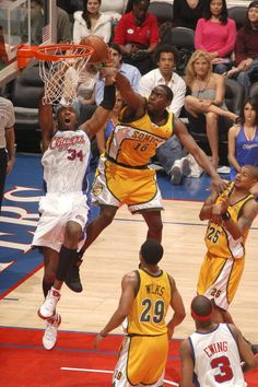 8b180bf96bd Vin Baker of the Los Angeles Clippers shoots against Noel Felix of the Seattle  SuperSonics on