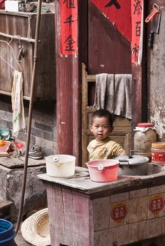 Young boy in tulou house, Hakka country. The Hakka country is 3 hours drive from Xiamen.