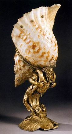 Endris Degen II, a German goldsmith, active 1555-1583 in Augsburg. Here, a Seashell Cup, c.1580. The shell of a knobbed Triton, gilt silver; height 41 cm/Kunsthistorisches Museum, Vienna