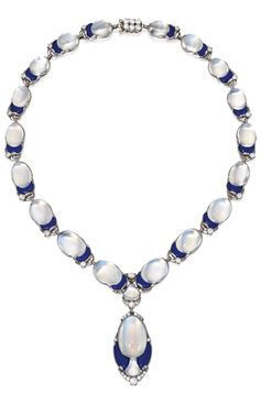 A Belle Epoque Platinum, Moonstone, Lapis Lazuli and Diamond Necklace, Tiffany & Co., Designed by Louis Comfort Tiffany, circa 1915. The drop-style necklace of slightly graduated design, composed of variously-shaped moonstone cabochons, each decorated with lapis lazuli segments, further set with round, old European and single-cut diamonds, signed Tiffany & Co.