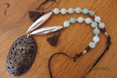 Necklace with wooden pendant, blue frosted amazonite gemstone beads, small tassels and silver beads.  $30 www.etsy.com/shop/casanoni