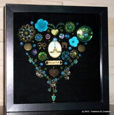 Heart made with Czech glass buttons, vintage buttons, antique bronze charms & broches, this is so far one of my favourite. I really like the colors. :-)