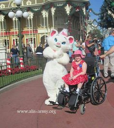 Ali with one of the Aristocats in the Magic Kingdom.