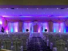 Beautiful #uplighting behind #drapes for this #wedding #ceremony! #RentMyWedding #DIY #weddinginspiration