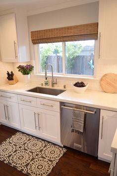 Accessorizing a white kitchen is so fun and easy with rugs, vases and towels from HomeGoods.  Sponsored Pin.