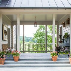 """Southern Living Idea House Charlottesville Bunny Williams There's a large oversize soapstone sink designed by the architect in the """"dogtrot"""" space between the garage and back door:  """"It's a great place to arrange flowers or to wash up before going inside,"""