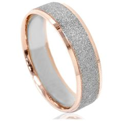 Item #: WB6541Width: 6 mmWeight: 5.5 gMetal: 14k Rose Gold This classic wedding beand features a textured brusehd white gold center and brightly polished rose gold edge. It measures 6mm and made in s