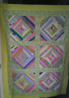 Scrappy baby quilt....I loved making these squares.