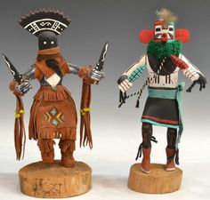 "American Indian Kachina dolls: (1) ""Apache Dancer"" signed J.C. under base, wood sculpture with leather, small turquoise stone at waist center, sculpture: 12.5""h, 8""w, 4""d, base: 1.5""h, 5.5""w, 5.75""d; (1) Corn Dancer, signed Victor Begay, sculpture: 12.25""h, 6.75""w, 4""d"