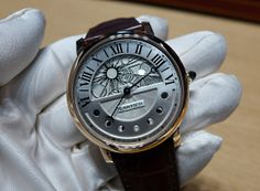 Cartier's Rotonde de Cartier Day and Night offers an oversize day/night or sun/moon display on the upper portion of the dial and a retrograde moon phase display on the lower part of the dial. #SIHH2014