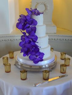 #wedding cake, purple orchids - wedding designed & planned by Cranberry Blue Weddings, photo by Steven Brooks