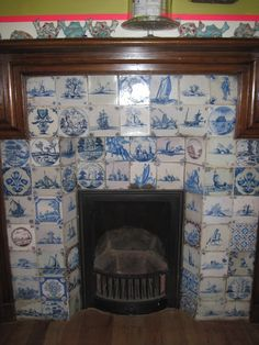 Dutch Delft Tiles around a cozy fireplace. Dining Room Fireplace, Cozy Fireplace, Tiled Fireplace, Blue Willow China, Blue And White China, Antique Tiles, Vintage Tile, Vintage Fireplace, Delft Tiles