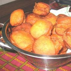 Mandazi (Andazi, singular), a delicacy enjoyed by Kenyans, are donut-like, deep-fried pastries similar to the West African puff puff or the American beignet. They can be served warm for breakfast or afternoon tea. Or even eaten cold as a snack or as desse Unique Recipes, Sweet Recipes, Ethnic Recipes, Kenyan Recipes, African Recipes, Breakfast Recipes, Snack Recipes, Snacks, Dessert Recipes