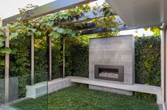 Port Melbourne - Ben Scott Garden Design   Outdoor fireplace