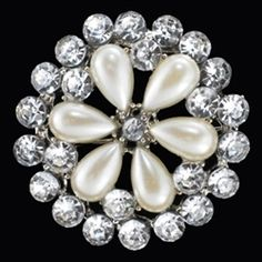 Sunburst Style Rhinestone pin is 1 1/4 inches in diameter. Crystal Clear Rhinestones and light cream Faux Pearls. Silver Plated Base Metal. Beautiful Pearl Brooch is only $13.99. #wedding brooch# wedding brooch rhinestone# bridal pin for dress# bridal pin# bridal pin brooch# brooches for wedding# brooches for women #brooches and pins# wedding accessories# bridesmaids accessories or bridal accessories# bridal gifts# bridesmaids gifts# sunburst pin# round brooch.