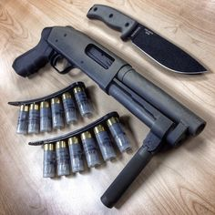 This is a modified Mossberg cut down with a spring loaded forward grip and custom paint job. Tactical Shotgun, Tactical Gear, Weapons Guns, Guns And Ammo, Ninja Weapons, Revolver, Custom Guns, Fire Powers, Cool Guns
