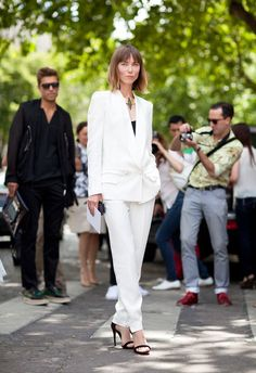 Fall 2012 Couture Street Style: A tailored white suit like Anya Ziourova's is chic staple in the warm-weather months.