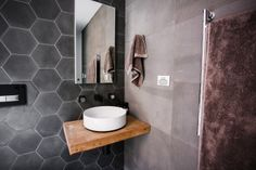 This stylish bathroom appeared on The Block Fans vs. Faves. It features Hexagonal Charcoal tile from Beaumont Tiles. #TheBlock
