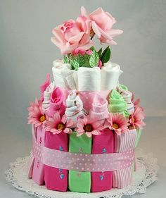 Like this as an alternative to the traditional diaper cake.  It uses onsies, rompers, and wash clothes.